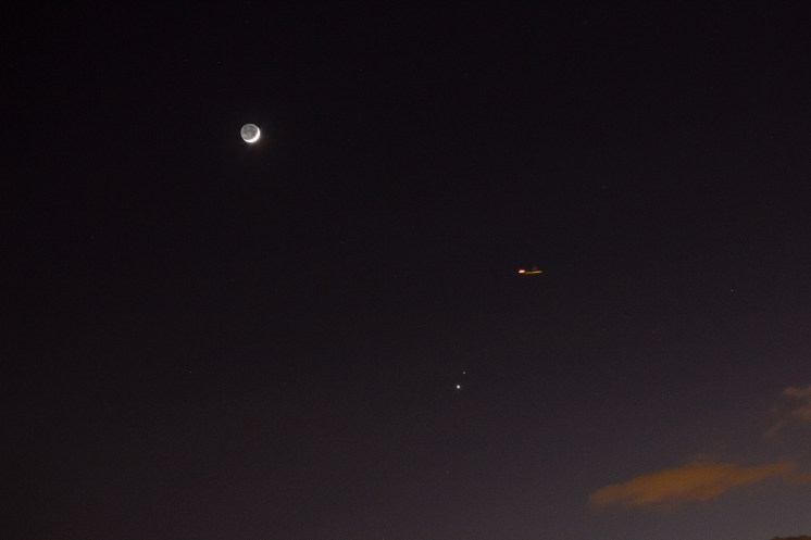 Plane intercepting Earthshine waxing moon and Mars Venus Conjunction