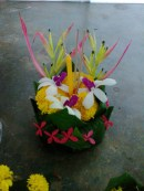 My finished Krathong! Made with a banana tree trunk banana leaves, and flowers.