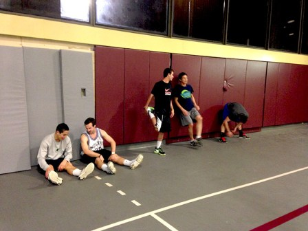 Players stretching in the West Gym before their dodge ball game on Tuesday.