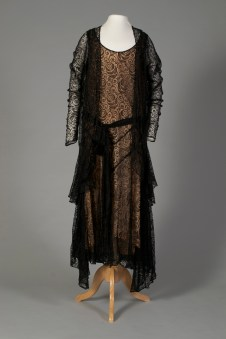 French, ca. 1929. Black machine-made Chantilly lace with pink silk slip. Here is an example of the jacket, which would not be taken off while wearing the ensemble.