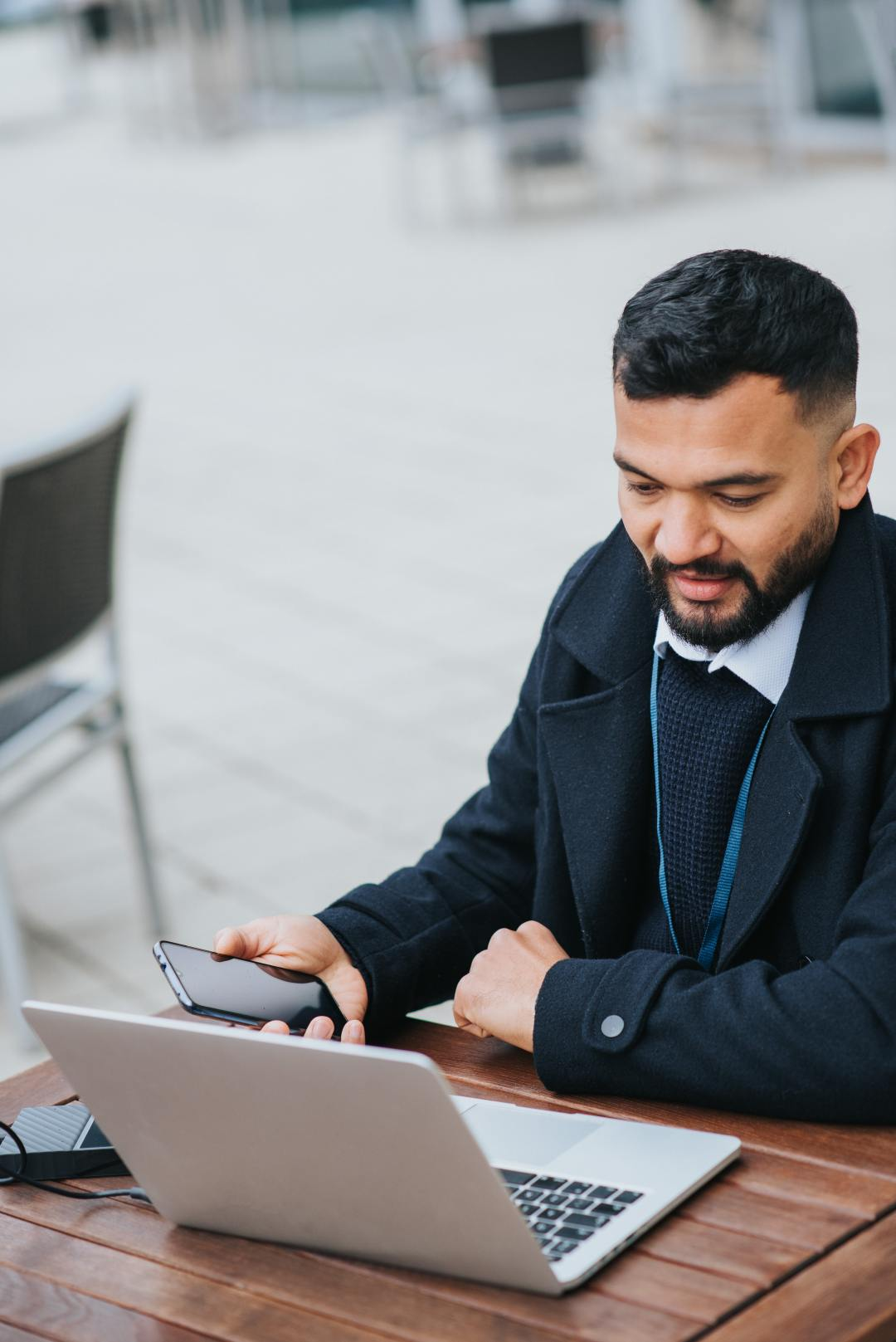 A man sitting and looking at his laptop.
