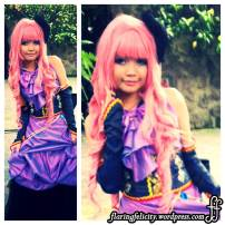 Her purple dress complements her pink hair. Many FQ3 cosplayers came in dresses today.