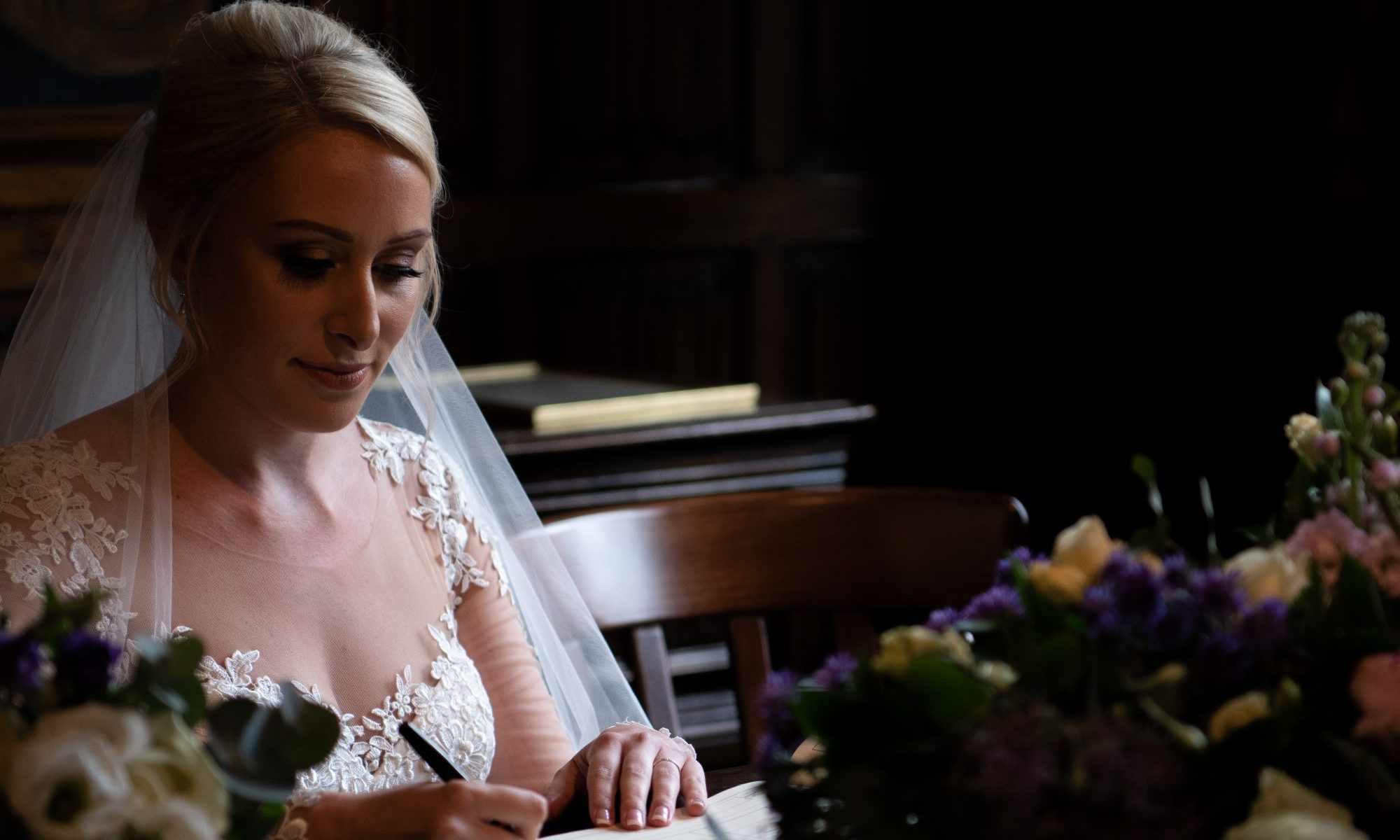 Bride signing the registry book on our Affordable Wedding Photography page