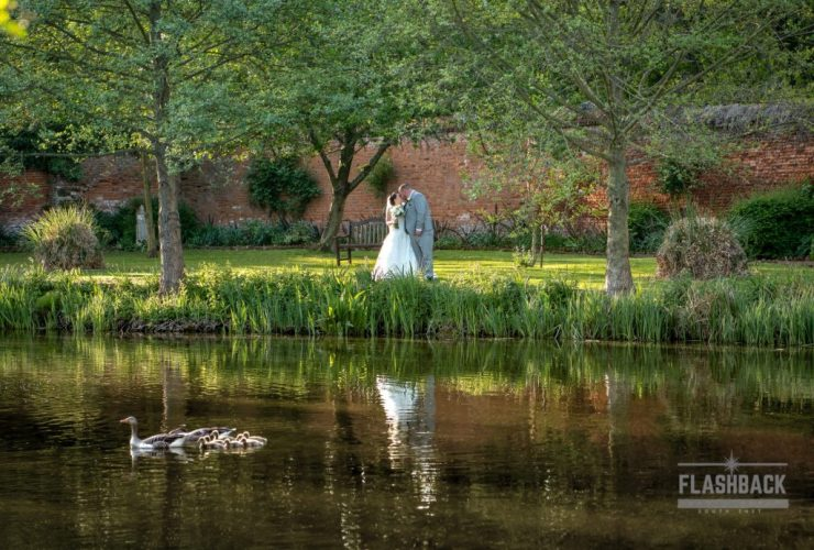 Essex Wedding Photography Bride and Groom kissing behind a lake. Kent Sussex Surrey Essex also located in our Essex Wedding Gallery