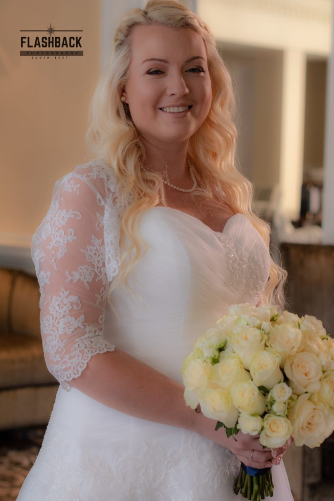 Bride with her bouquet. Kent Sussex Surrey Essex