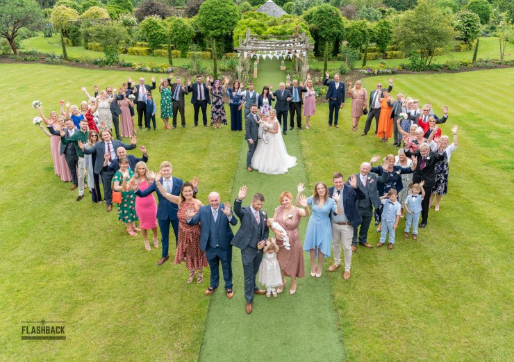 Contact us - Group heart shot with Bride and Groom in centre