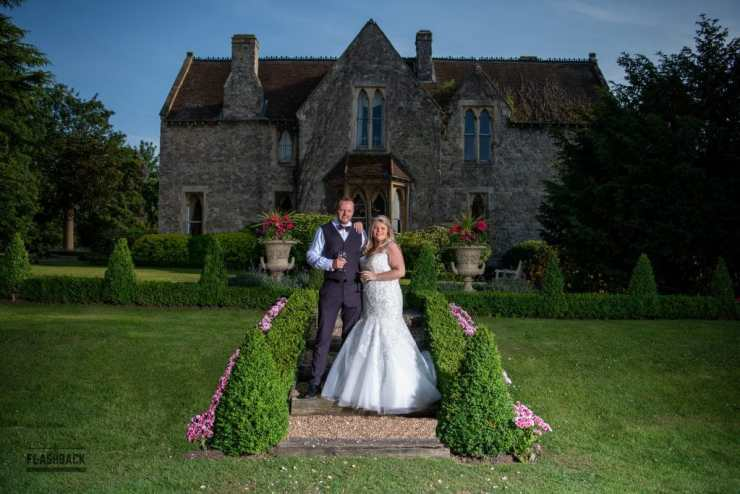 Kent Wedding Gallery - Bride and Groom posing in front the Knowle Country House in Kent