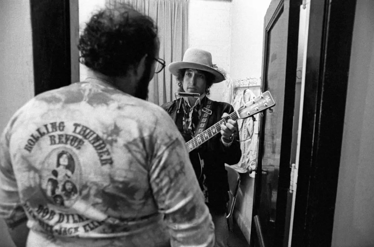 Bob Dylan standing in dressing room doorway
