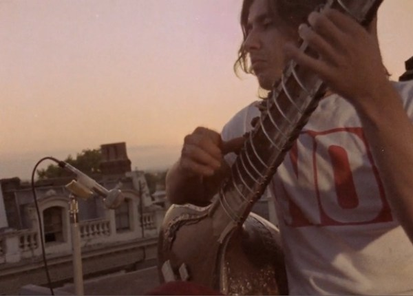 A sitar player kicks off and ends Gannon's film