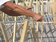 3.Push down to sink the teeth into the truss.