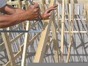 2. Teeth grab the truss sides for secure install.