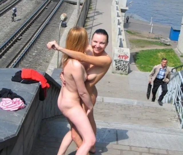 Girls Naked Outdoors Hugging On Rail Bridge