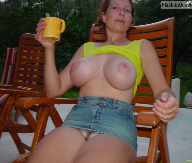 Kinky Mom Flashes Her Trimmed Snatch As She Shows Massive Breasts