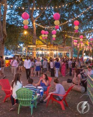 Residents and visitors to The Oval in Philadelphia's famed Benjamin Franklin Parkway, take part in one of the city's pop up beer gardens under a canopy of warm party lights and festive lanterns.