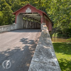 Manasses Guth Covered Bridge is a 108-foot-long, Burr Truss bridge, that crosses Jordan Creek near South Whitehall Township, Lehigh County, Pennsylvania. It was originally constructed in 1858, rebuilt in 1882, and was listed on the National Register of Historic Places in 1980.