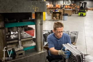 Aynor, SC -- Stan Parker, 51, of Aynor, SC works on stamping receivers for rifles out of sheet metal at PTR Industries on Thursday, July 16, 2015. Parker is a local resident who was hired by PTR to staff their manufacturing facility in Aynor after moving from Bristol, Conn., in the spring of 2014 following the passage of strict gun laws in their home state during the wake of the 2012 Newtown shooting. -- Photo by Brett Flashnick, Freelance