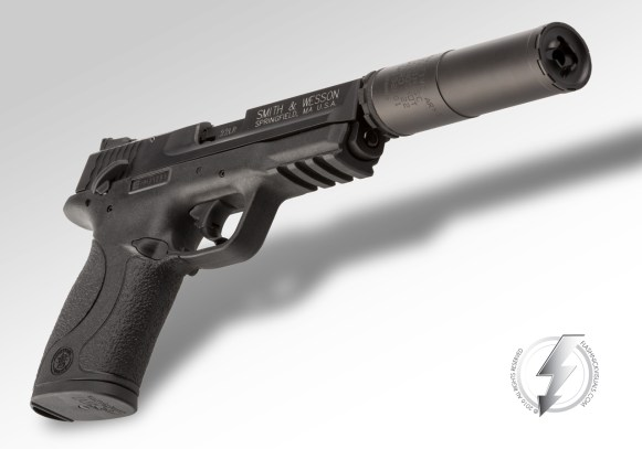 """The Innovative Arms, LLC Slingshot Micro, Multi-Caliber suppressor pictured on a Smith & Wesson Corp. M&P® 22 host. We had the opportunity to photograph this product in studio on October 20, 2015 for the SHOT Show 2016 product launch.The Slingshot Micro consists of a patented 3-piece design, measures 3.9"""" in length, weighs in at 5.7oz, and is rated for 35-38 Db of sound suppression (dry) when firing .22 LR (full auto), .17HMR, .17 Mach II, .22 Magnum, and 5.7x28."""