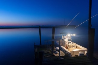 Fishermen load their boat at a dock in Bennetts Point, Green Pond, SC, as they prepare for a day of Mahi fishing in the gulf stream on Sunday, May 31, 2009.