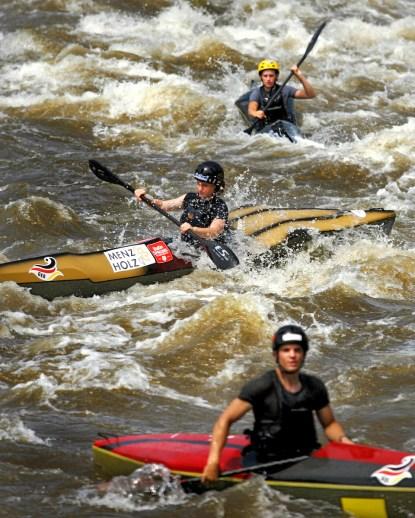 Young, Kyak and Canoe Racers, from around the world practice for the 2007, Junior Wildwater World Championships, Monday, July 16, 2007, at the Millrace Rapids, near Riverbanks Zoo in Columbia, S.C. (© 2007 Brett Flashnick/flashnick | visuals)