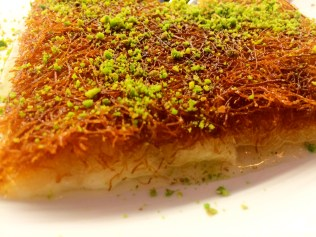 Kanafeh - fried cheese covered in sugary sauce with thin stringed phyllo dough