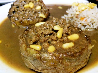 Artichoke stuffed with ground beef/lamb and topped with pine nuts