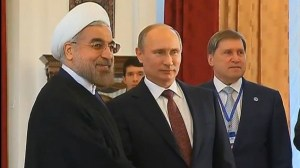 Russian President Vladimir Putin poses for photographers with his Iranian counterpart, Hasan Rouhani, on the sidelines of the Shanghai Cooperation Organization summit in Bishkek, Kyrgyzstan, Friday, September 13, 2013 (photo credit: via YouTube/Times of Israel).