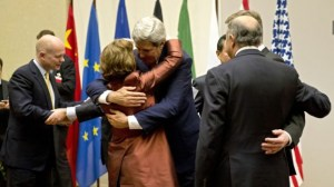 US Secretary of State John Kerry, center, embraces EU foreign policy chief Catherine Ashton, during a ceremony at the United Nations after an agreement was reached on Iran's nuclear program, in Geneva, Switzerland, Sunday, Nov. 24, 2013. (Photo credit: AP Photo/Keystone, Martial Trezzini/Times of Israel)