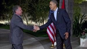 President Barack Obama greets Jordan's King Abdullah II at The Annenberg Retreat at Sunnylands, Rancho Mirage, Calif., Friday, Feb. 14, 2014. (photo credit: AP Photo/Jacquelyn Martin/Times of Israel)