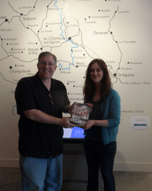 "Presenting a signed copy of ""The Auschwitz Escape"" to the staff of Le Chambon's museum."