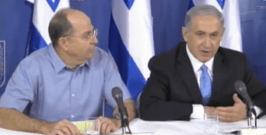 PM Netanyahu (right) and Defense Minister Yaalon (left) address the nation and reporters on Saturday evening. (Source: Ynet)
