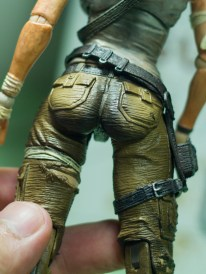 Very intricate detailing for her cargo pants, and you can see skin tones through the rips in them. And yes again, nice bottom.