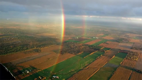 Here is a rainbow taken from an airplane which shows the right lower part of the circle.