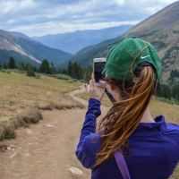 woman taking photo of mountain