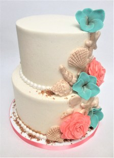 two tier wedding cake coral blue gold shells flowers