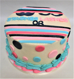 gender reveal staches or lashes cake 2