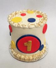 red blue yellow smooth polka dot smash cake