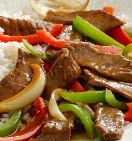 This Ginger Pepper Steak recipe will transport your taste buds to Asia with it\'s quick-cooking steak and bell peppers in a flavorful ginger sauce. #Asian #beef #dinnerideas
