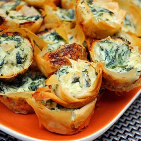 Spanakopita Bites are mini phyllo pastry shells filled with a delicious spinach and feta cheese filling.