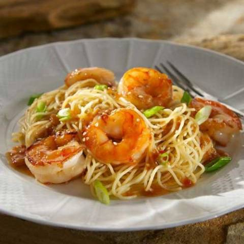 In little more than the time it takes to boil water you have got dinner on the table with this quick-to-fix Chili Garlic Shrimp with Sesame Noodles.