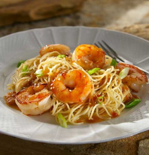 In little more than the time it takes to boil water you have got dinner on the table with this quick-to-fix Chili Garlic Shrimp with Sesame Noodles. #shrimp #noodles #dinnerideas