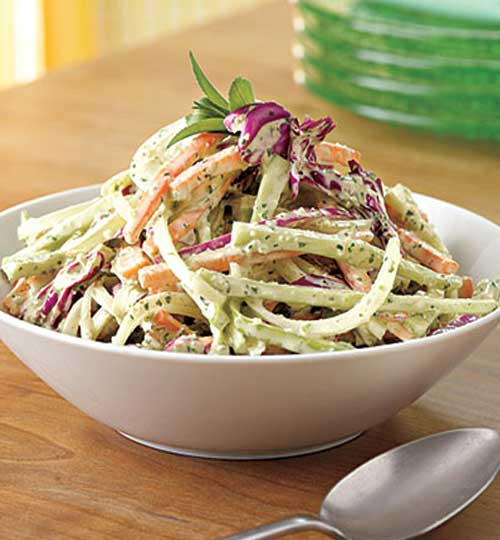 Breathe some life into coleslaw with tarragon, basil and garlic. You can make this Green Goddess Slaw up to a day ahead. Keep it covered in the fridge until you are ready to serve. #slaw #salad #sidedish