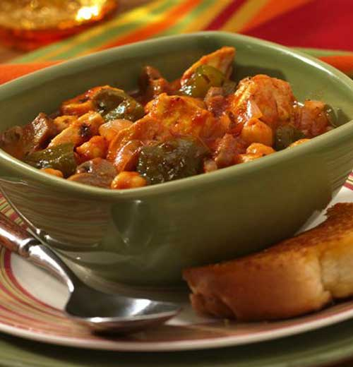Dig into a simple dish of chicken slow-cooked with bell peppers, convenient canned mushrooms, and hearty garbanzo beans. #stew #dinnerideas #slowcooker #chicken