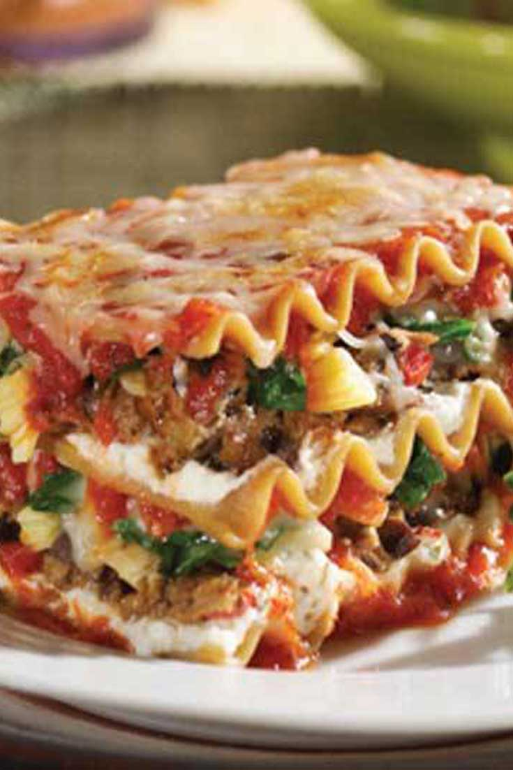 This Lasagna with Spinach is both filling and satisfying. Not only does it have sausage, ground beef and three types of cheese; it also has all those veggies stuffed in. With all of the other goodness, we are sure picky eaters won\'t mind. #lasagna #dinnerideas