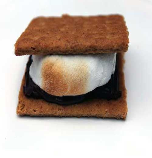 """The first record of s'mores was a recipe in a 1927 Girl Scouts publication. Yes, the name does seem to be derived from everyone wanting """"some more."""" #dessert #smores #chocolate"""
