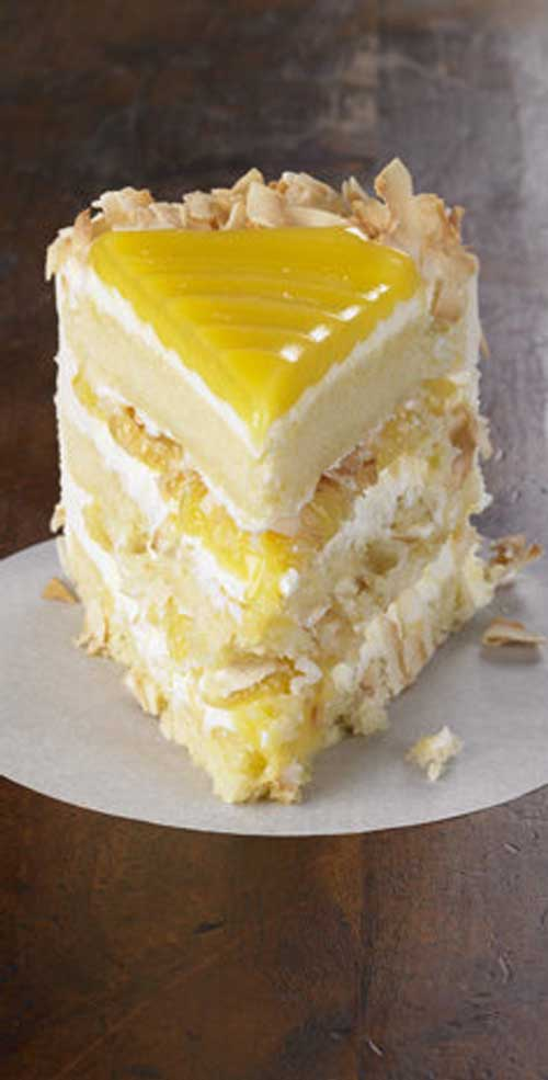 Tangy lemon filling between layers of tender white cake. Top it all off with a rich coconut-cream cheese frosting. Some people think that this Lemon Coconut Cake is the best cake they've ever eaten.