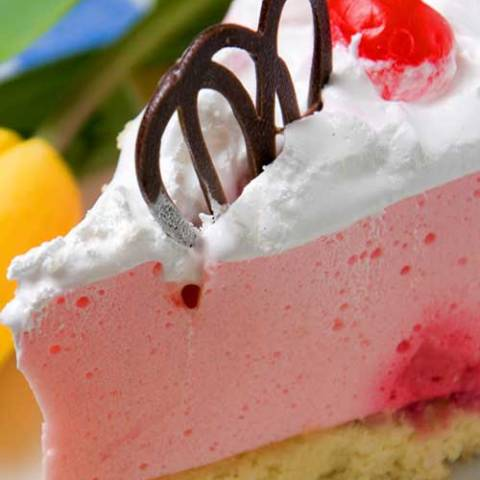 Recipe for Strawberry Cheesecake - A light and fluffy no bake cheesecake recipe, complete with a fancy chocolate garnish.