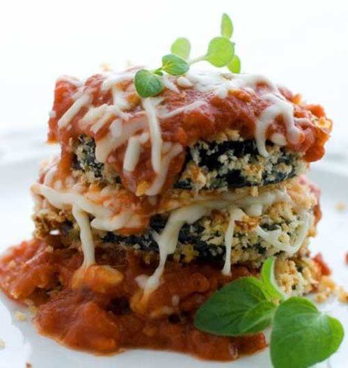 Recipe for Baked Eggplant Parmesan - These crisp, cheesy eggplant slices are a lighter take on the more traditional fried eggplant Parmesan.
