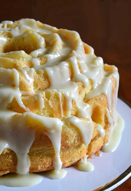Recipe for Ultra Lemon Cake - The cake's soft and fine, with a delightful and refreshing lemony tang. I've made adjustments such as reducing the sugar and the amount of topping and I think the only improvement needed is more lemon rind.