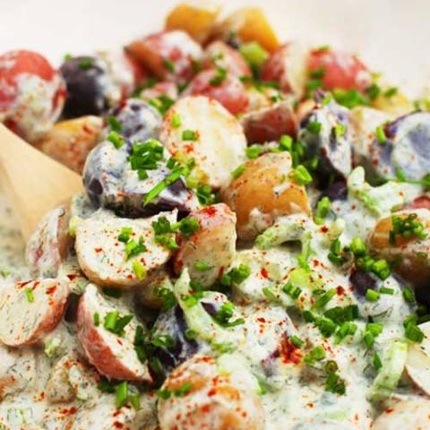 Recipe for Yogurt Dill Potato Salad - Most potato salad recipes use mayonnaise, but today I am sharing a variation using Greek non-fat plain yogurt. Using yogurt adds a slight creamy tang to the potatoes which I absolutely love.