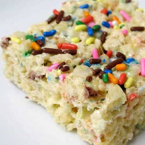 Recipe for Cake Batter Rice Krispie Treats - This recipe brings back a favorite sticky childhood treat, and the fun of licking the cake batter spoon.